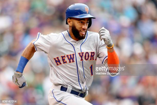 Amed Rosario of the New York Mets runs down the first base line in the sixth inning against the Colorado Rockies at Coors Field on August 3 2017 in...