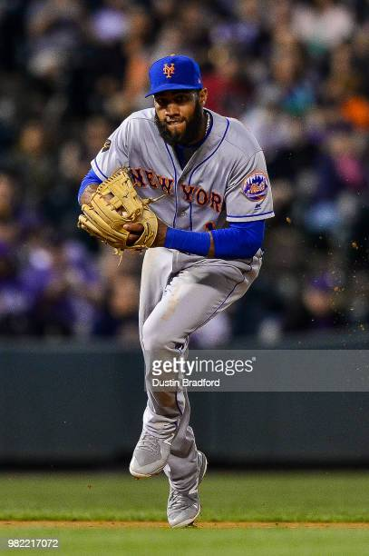 Amed Rosario of the New York Mets sets to throw out a runner after fielding a ground ball against the Colorado Rockies at Coors Field on June 18 2018...