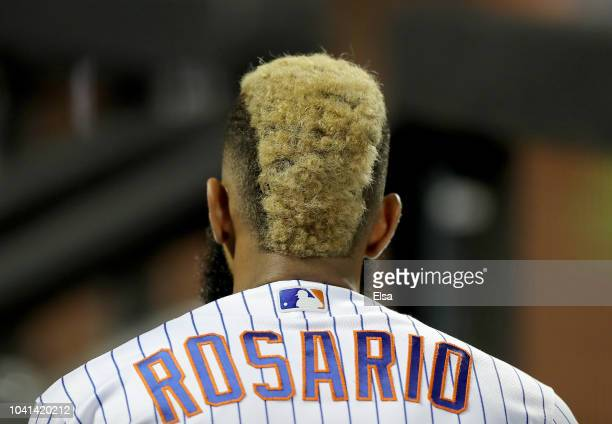 Amed Rosario of the New York Mets sits in the dugout in the fourth inning against the Atlanta Braves on September 26 2018 at Citi Field in the...