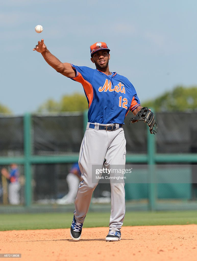 Amed Rosario #12 of the New York Mets throws a baseball during the Spring Training game against the Detroit Tigers at Joker Marchant Stadium on March 21, 2015 in Lakeland, Florida. The Tigers defeated the Mets 6-4.