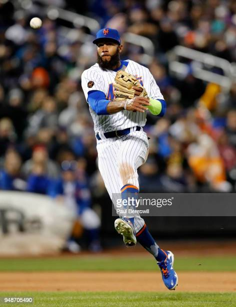 Amed Rosario of the New York Mets throws on the run to first base for the out after fielding a slow grounder in an MLB baseball game against the...
