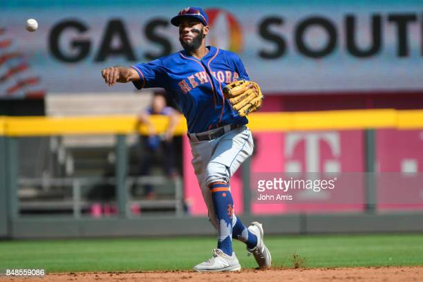 Amed Rosario of the New York Mets throws out Ender Inciarte of the Atlanta Braves at first base in the seventh inning at SunTrust Park on September...