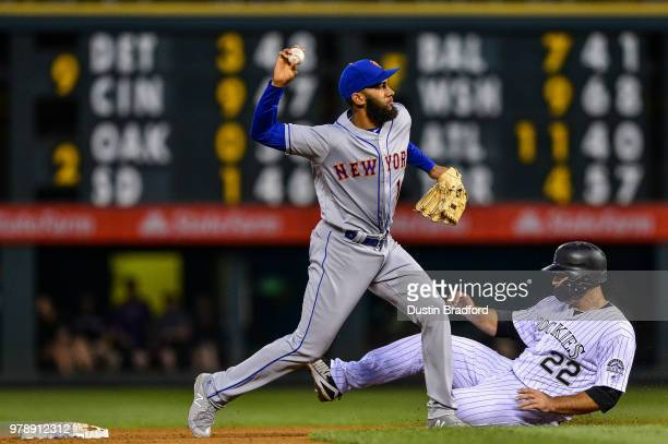 Amed Rosario of the New York Mets throws to first base after forcing out Chris Iannetta of the Colorado Rockies in the second inning of a game at...