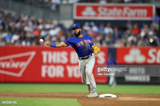 Amed Rosario of the New York Mets throws to first base during the game against the New York Yankees at Yankee Stadium on Monday August 14 2017 in the...