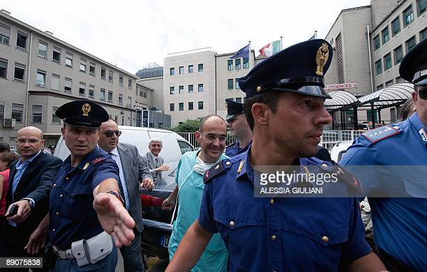 Amedeo Manuel Mancini Umberto Parini hospital's surgeon who leaded the operation of Pope Benedict XVI is escorted by policemen as he arrives to speak...