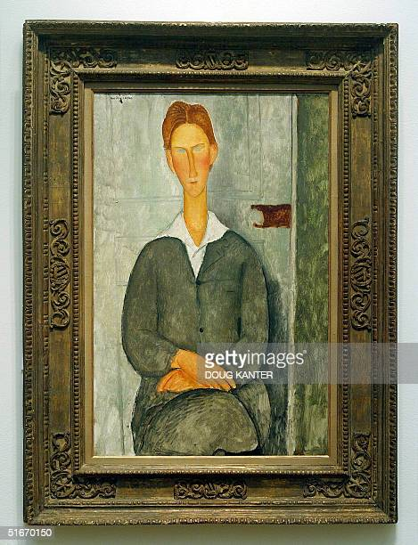 Amedeo Modigliani's 'Giovanotto Dai Capelli Rossi' is seen at Sotheby's auction house in New York 01 November 2002 Sotheby's will host a sale of...
