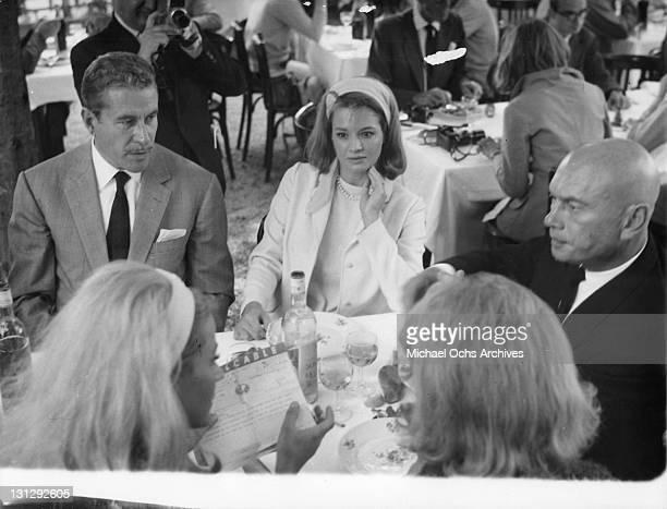 Amedeo Nazzari Angie Dickinson and Yul Brynner have lunch after press conference for the film 'The Poppy Is Also A Flower' 1966