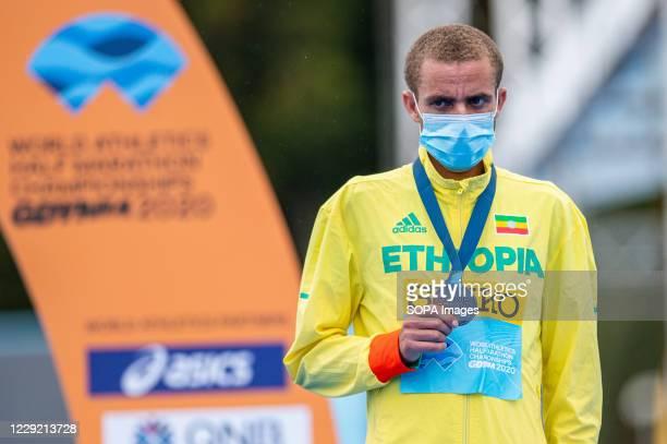 Amedework Walelegn of Ethiopia with a bronze medal on the podium of 2020 IAAF World Half Marathon Championships in Gdynia