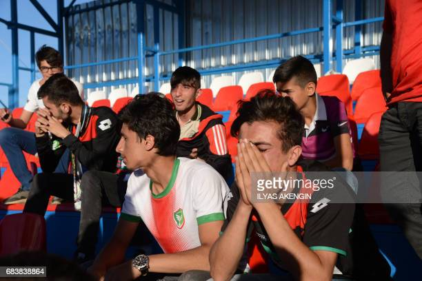Amedspor fans react on May 16 2017 after Amedspor lost the Turkish Super Lig white group semifinal second leg football match against Erzurum BB at...