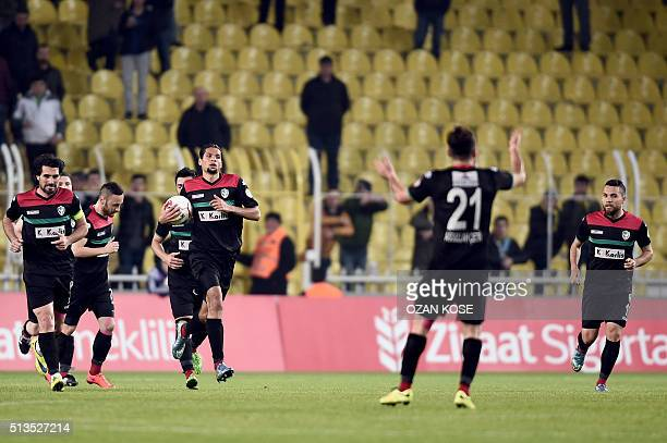 Amedspor's Kamil Icer celebrates with his teammates after scoring a goal during the Zirrat Tukish Cup football match between Fenerbahce and Amedspor...