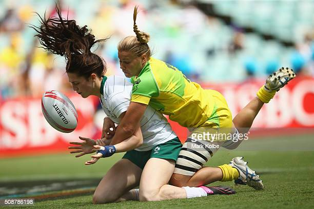 Amee Leigh Murphy Crowe of Ireland loses the ball as she is tackled over the try line by Nicole Beck of Australia during the 2016 Sydney Sevens...