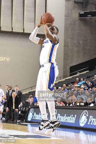 Ameen Tanksley of the Hofstra Pride takes a jump shot during the Colonial Athletic Conference Championship college basketball game against the North...