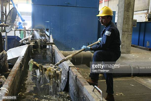 Ameen Uddin at Hyperion sewage treatment plant near LAX removes trash that has been separated from incoming wastewater The trash is filtered out of...