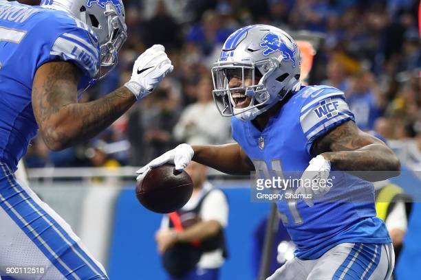 Ameer Abdullah of the Detroit Lions celebrates his touchdown against the Green Bay Packers during the fourth quarter at Ford Field on December 31...