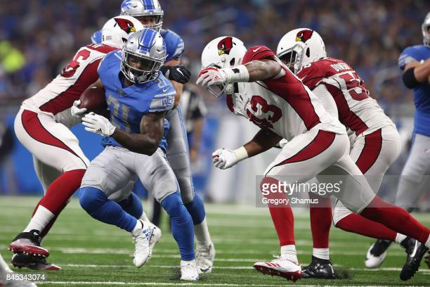 Ameer Abdullah of the Detroit Lions dodges a tackle from Haason Reddick of the Arizona Cardinals in the first half at Ford Field on September 10 2017...