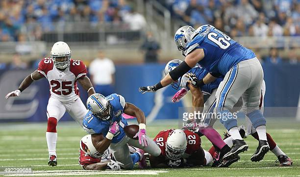Ameer Abdullah of the Detroit Lions fumbles the ball in the second quarter after being hit by the Arizona Cardinals defense men on October 11, 2015...