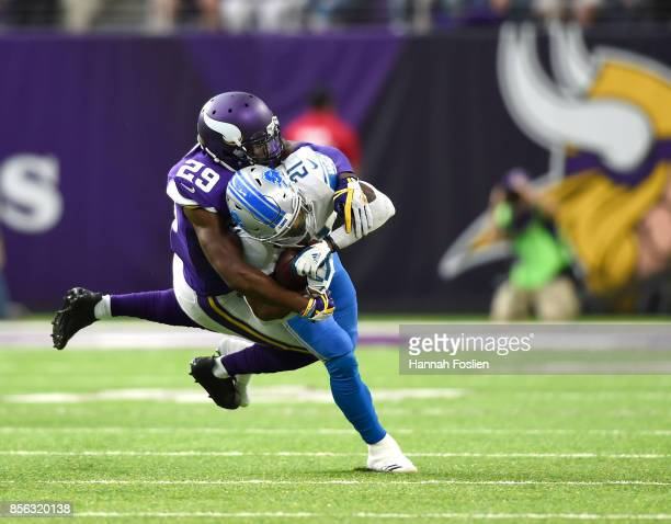 Ameer Abdullah of the Detroit Lions is tackled with the ball by defender Xavier Rhodes of the Minnesota Vikings in the first quarter of the game on...