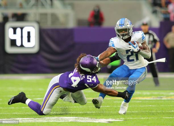 Ameer Abdullah of the Detroit Lions spins away from defender Eric Kendricks of the Minnesota Vikings in the first quarter of the game on October 1...