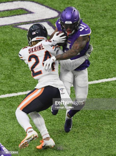 Ameer Abdullah of the Minnesota Vikings avoids a tackle by Buster Skrine of the Chicago Bears during the third quarter of the game at U.S. Bank...