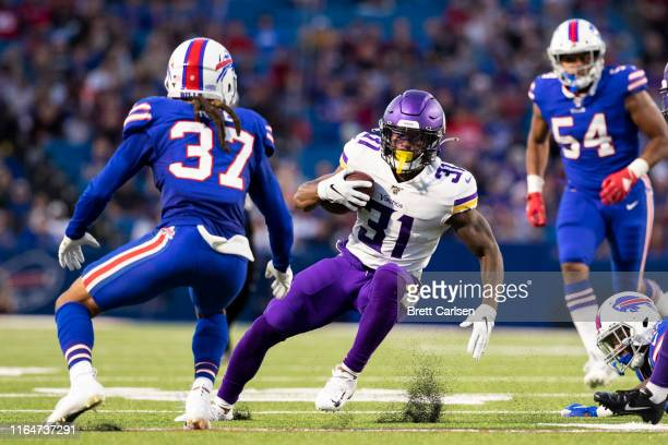 Ameer Abdullah of the Minnesota Vikings carries the ball during the first half of a preseason game against the Buffalo Bills at New Era Field on...