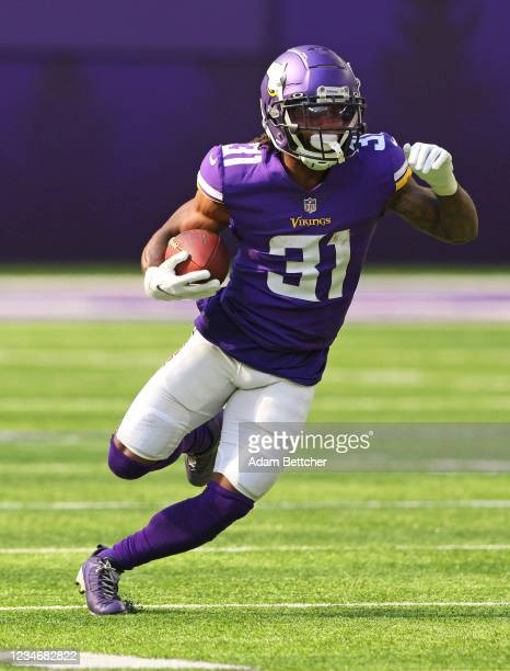 Ameer Abdullah of the Minnesota Vikings carries the ball for a gain in the first quarter of preseason play against the Denver Broncos at U.S. Bank...