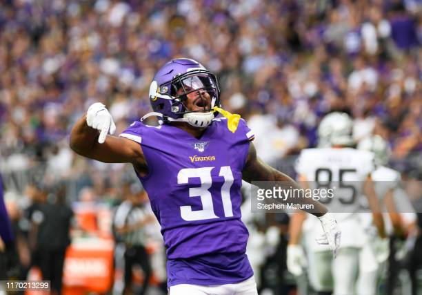 Ameer Abdullah of the Minnesota Vikings celebrates after tackling Jalen Richard of the Oakland Raiders in the second quarter of the game at U.S. Bank...