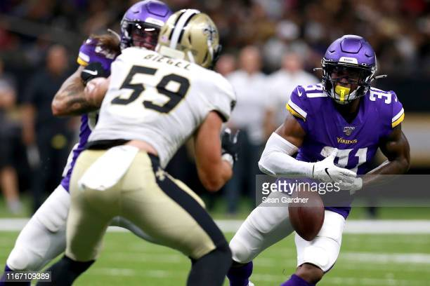 Ameer Abdullah of the Minnesota Vikings fumbles the ball during the first half of a preseason game against the New Orleans Saints at Mercedes Benz...