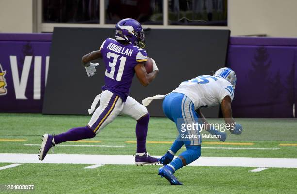 Ameer Abdullah of the Minnesota Vikings gets past Will Harris of the Detroit Lions to score a touchdown in the second quarter at U.S. Bank Stadium on...