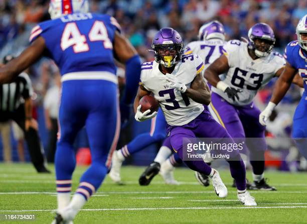 Ameer Abdullah of the Minnesota Vikings runs the ball during the first half of a preseason game against the Buffalo Bills at New Era Field on August...