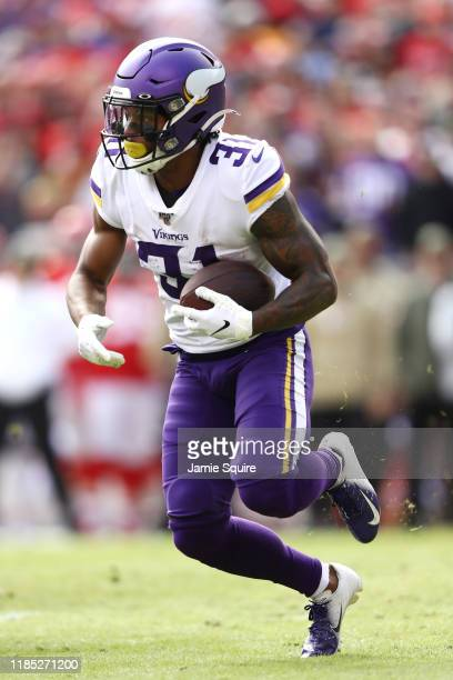 Ameer Abdullah of the Minnesota Vikings runs with the ball during the first half against the Kansas City Chiefs at Arrowhead Stadium on November 03,...