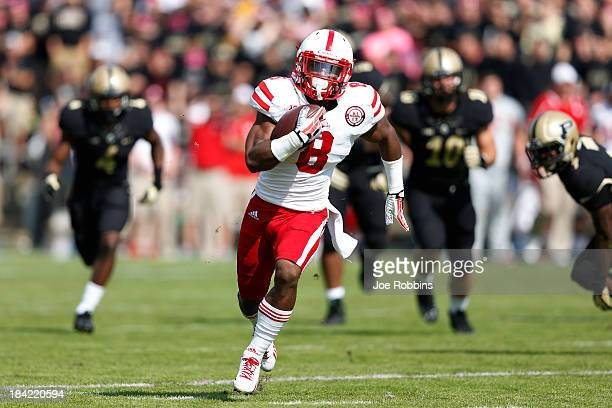 Ameer Abdullah of the Nebraska Cornhuskers runs for a 28yard touchdown in the first half of the game against the Purdue Boilermakers at RossAde...
