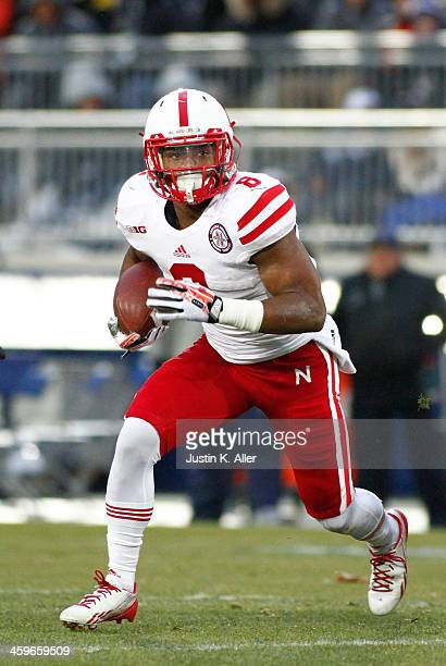 Ameer Abdullah of the Nebraska Cornhuskers rushes against the Penn State Nittany Lions during the game on November 23 2013 at Beaver Stadium in State...