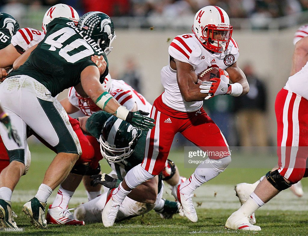 Ameer Abdullah #8 of the Nebraska Cornhuskers tries to get around the tackle of Max Bullough #40 of the Michigan State Spartans during a fourth quarter run at Spartan Stadium Stadium on November 3, 2012 in East Lansing, Michigan. Nebraska won the game 28-24.