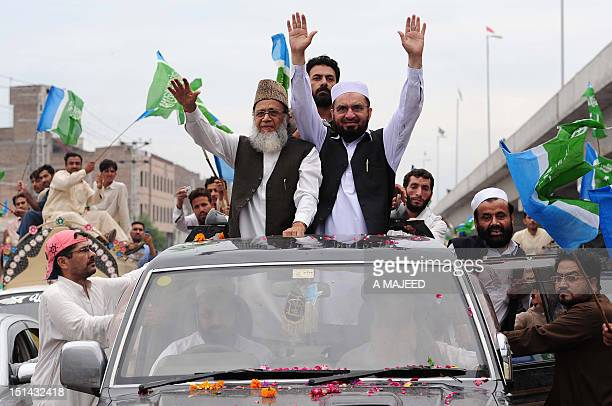 Ameer of Jamaat e Islami Pakistan Munawar Hassan waves to supporters during a rally in Peshawar on September 7 against the reopening of NATO supplies...