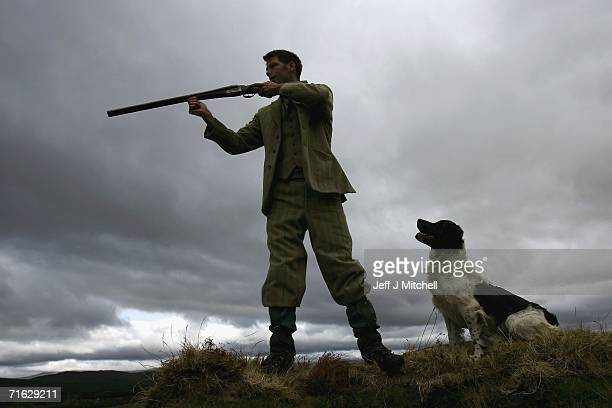 amekeeper Andrew Drummond stands with his springer spaniel on Drumochter Moore on the Milton Estate on August 11 2006 Dalwhinnie in ScotlandThe Game...