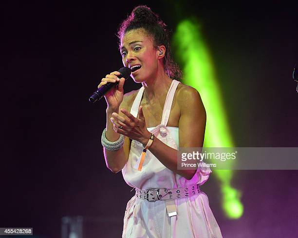 Amel Larrieux performs at ONE MusicFest at Aaron's Amphitheatre on September 13 2014 in Atlanta Georgia