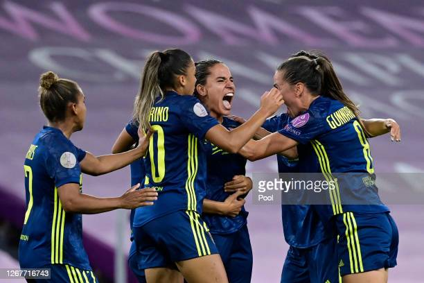 Amel Majri of Olympique Lyon celebrates with teammates after scoring her team's second goal during the UEFA Women's Champions League Quarter Final...