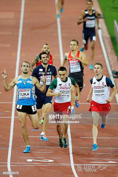 Amel Tuka of Bosnia and Herzegovina Adam Kszczot of Poland and Marcin Lewandowski of Poland cross the line in the Men's 800 metres semifinal during...
