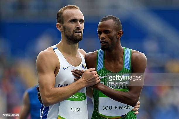 Amel Tuka of Bosnia and Herzegovina and Ayanleh Souleiman of Djibouti react after competeing in round one of the Men's 800 metres on Day 7 of the Rio...