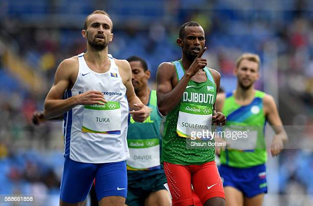 Amel Tuka of Bosnia and Herzegovina and Ayanleh Souleiman of Djibouti compete in round one of the Men's 800 metres on Day 7 of the Rio 2016 Olympic...