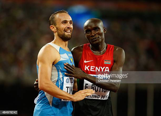 Amel Tuka of Bosnia and Herzegovina and Ferguson Cheruiyot Rotich of Kenya hug after the Men's 800 metres Semi final during day two of the 15th IAAF...