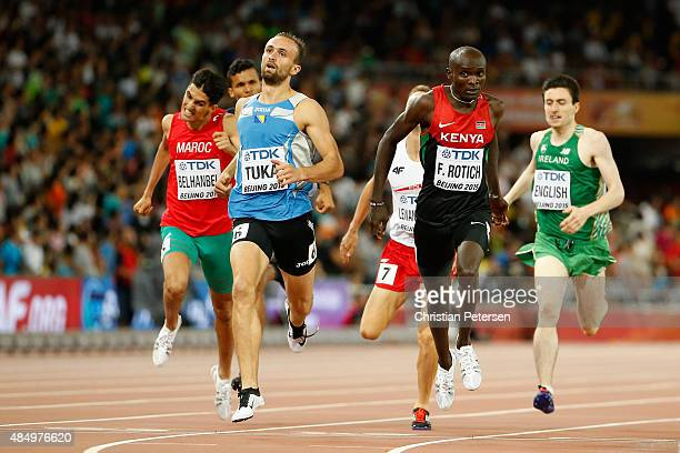 Amel Tuka of Bosnia and Herzegovina and Ferguson Cheruiyot Rotich of Kenya cross the finish line in the Men's 800 metres semifinal during day two of...