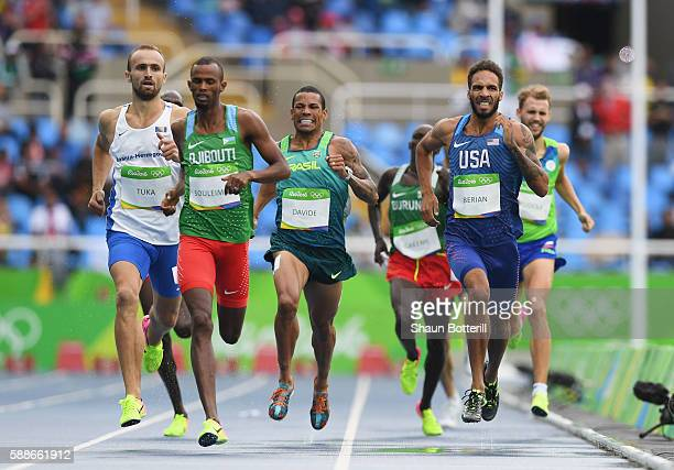 Amel Tuka of Bosnia and Herzegovina Ayanleh Souleiman of Djibouti and Boris Berian of the United States compete in round one of the Men's 800 metres...
