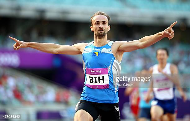 Amel Tuka of Bosnia and Herzegovina crosses the line to win the Men's 800 metres during day ten of the Baku 2015 European Games at the Olympic...