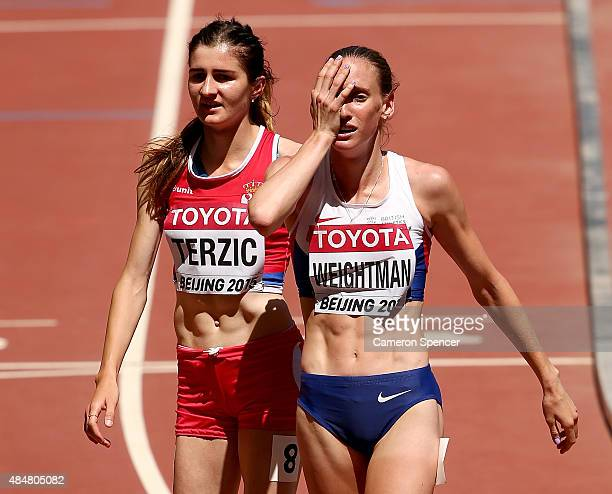 Amela Terzic of Serbia and Laura Weightman of Great Britain react after the Women's 1500 metres heats during day one of the 15th IAAF World Athletics...
