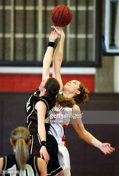 Amelia Abernathy of Occidental and Deven Aschtgen of Nebraska Wesleyan battle for ball on opening tipoff during the nonconference women's basketball...