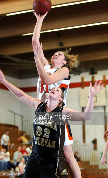 Amelia Abernathy of Occidental College shoots over Angie Schlect of Nebraska Wesleyan during the nonconference women's basketball game between...