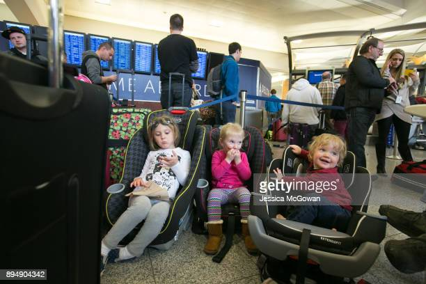 Amelia Ariel and Garrett Tyler wait in line with family and stranded passengers to check in for a flight at HartsfieldJackson Atlanta International...