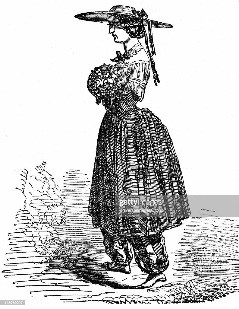 Amelia Bloomer (1818-1894) American feminist and champion of dress reform. The style of dress for women she designed and wore, and which gave the name of Bloomers for women's nether garments. Wood engraving, London, 1869.