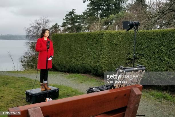 Amelia Brace,the North America correspondent for Australia's Channel 7 gives a live report in North Saanich, Vancouver Island, British Columbia poses...